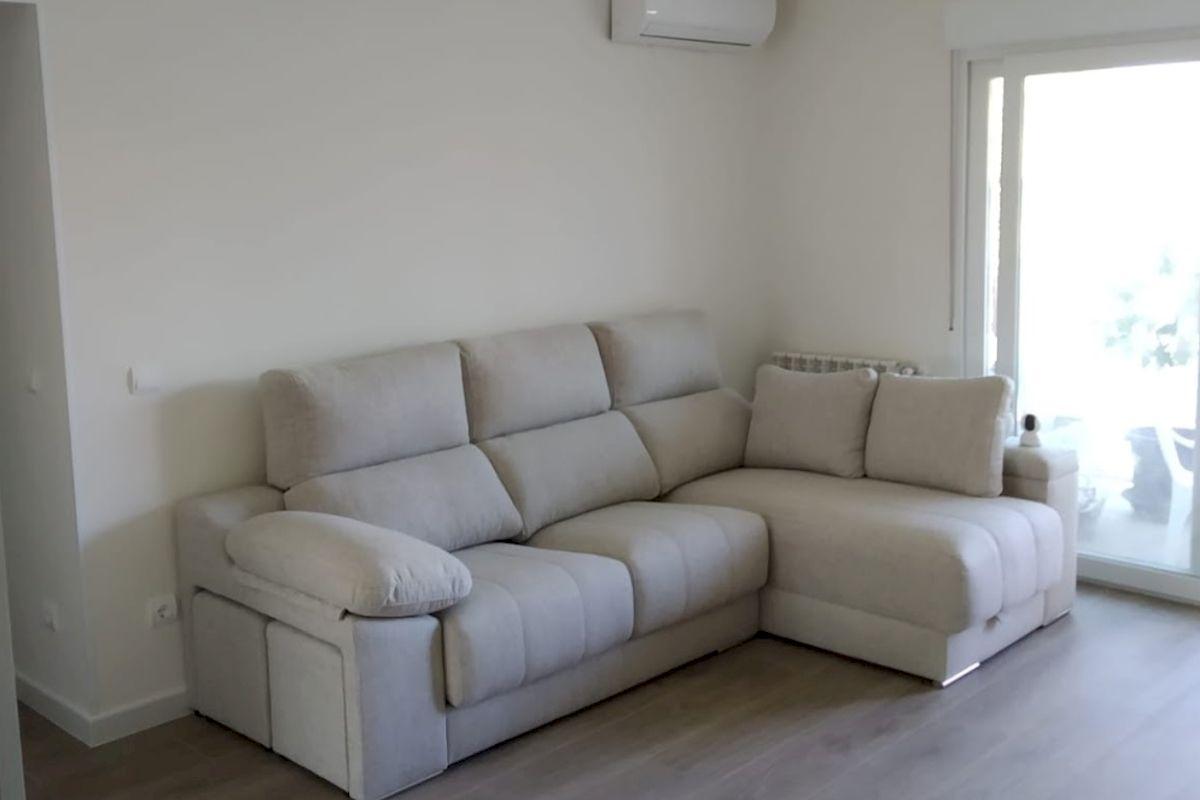 Detalle Reforma de salón Solados y mobiliario